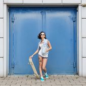 Young Brunette Woman Posing With Skateboard