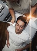 Man having facial laser rejuvenation procedure at clinic