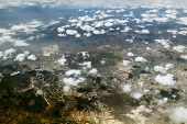Look At The Clouds And The Earth From A Height Of Ten Thousand Feet