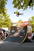 Young Man Practices Bicycle Jumps Before Bmx Competition
