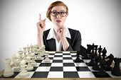 Composite image of thinking redhead businesswoman with chessboard