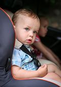 Cute Toddler Boy In Car Seat