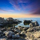 Calm Sea Wave On Rocky Shore