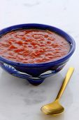 stock photo of chipotle chili  - Artisan mexican hot salsa in vintage talavera bowl with a delicious fresh hot flavor on vintage carrara marble table - JPG