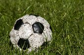 Old used shabby leather soccer ball