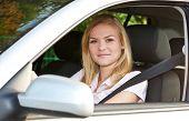 picture of scandinavian descent  - Attractive woman in her car - JPG