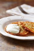 Potato cakes with sour cream on a plate