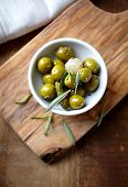 Pickled green olives, gherkins and onion