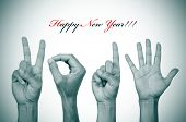 the text happy new year and man hands in black and white forming the number 2015
