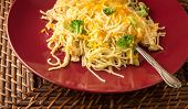 foto of shredded cheese  - Plate of delicious and easy to prepare chicken alfredo topped with shredded cheese and broccoli - JPG