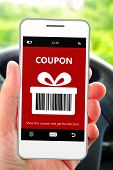 Hand Holding Mobile Phone With Christmas Coupon