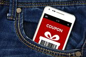 Mobile Phone With Christmas Coupon In Pocket