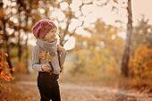 cute child girl portrait in autumn forest