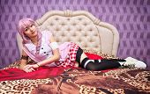 Beautiful Girl Relaxing Lying On The Bed. Cosplay Character
