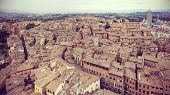 Retro Filtered Panoramic View Of Siena, Italy.