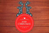 Banner and logo saying merry christmas against overhead of wooden planks