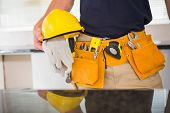 Close up of man with tool belt in a new house