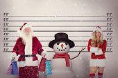 Santa carries some Christmas bags against mug shot background