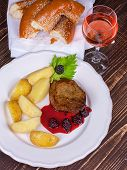 Grilled beef steak with blackberry sauce, glass of wine