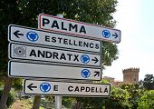 Roundabout sign and Andratx castle