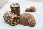 image of briquette  - Brown palm sugar briquettes on crushed paper - JPG