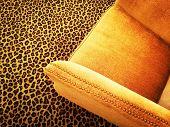 Orange Velvet Armchair On Leopard Carpet