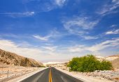 Desert road and blue sky in Death Valley national park
