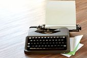 picture of faber  - Typewriter On A Table With Letterhead Paper - JPG