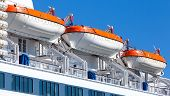stock photo of passenger ship  - Rescue boats on big passenger cruise ship - JPG