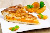 stock photo of apricot  - Apricot pie on a plate - JPG