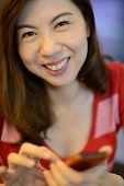 Smile Asian Woman Have Fun With Mobile Phone
