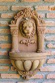 Vintage Lion Fountain On Brick Wall