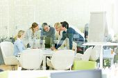 Team working together in office during a meeting