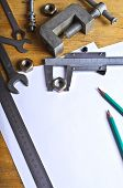 stock photo of micrometer  - Various tools and mechanical devices on the white blank sheets for recording - JPG