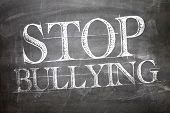 picture of stop bully  - Stop Bullying written on blackboard - JPG