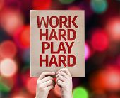 Work Hard Play Hard written on colorful background with defocused lights