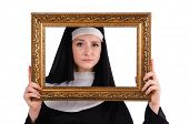 Young nun with frame isolated on white