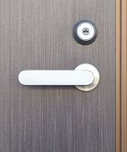 Gray wood door and sliver metal door handle