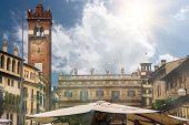 Square Piazza Delle Erbe On A Sunny Day. Verona, Italy