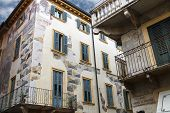 The Picturesque House With Murals On The Street Via Arche Scaligere In Verona, Italy