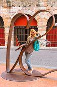 Attractive Girl Near Sculptural Composition
