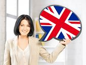 education, foreign language, english, people and communication concept - smiling woman holding text bubble of british flag