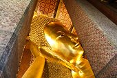 stock photo of recliner  - Reclining Buddha gold statue Wat Pho Bangkok Thailand - JPG