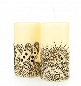 Beautiful candles with mehendi, isolated on white