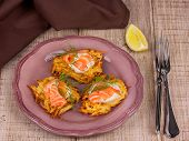 Golden potato fritters with salmon served with creamy sauce