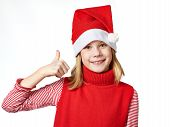 Beautiful Girl In Santa Hat With Thumbs Up Sign Ok Isolated