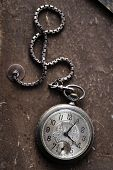 stock photo of edwardian  - very old watch on the grunge post card - JPG