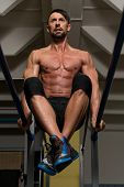 Fit Athlete Doing Exercise On Parallel Bars
