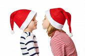 Girl And Little Boy In Santa Claus Hat