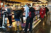 Customers Shop For Books In Hong Kong Airport